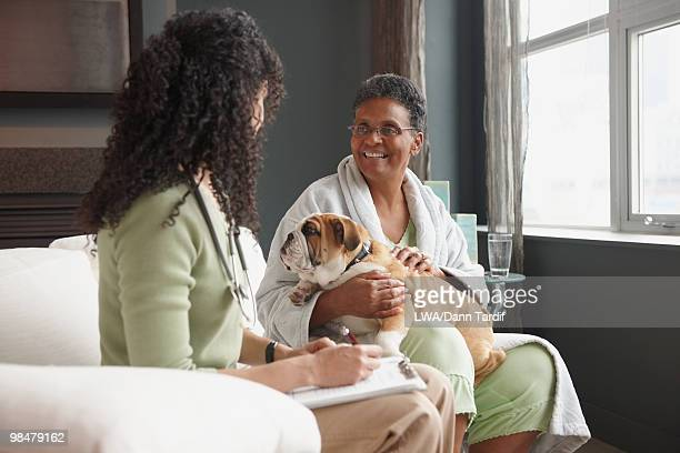 African American nurse checking on patient
