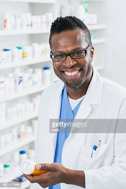 African American pharmacist filling a prescription