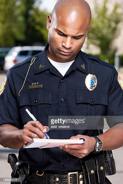 African American Police Officer Writing a Ticket