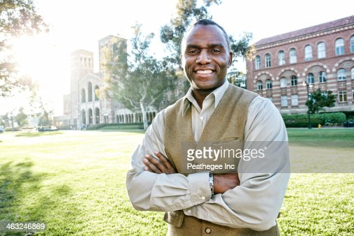African American professor smiling on campus