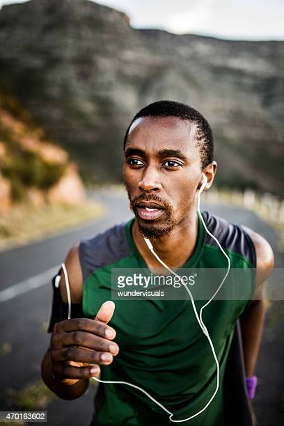 African American runner exercising while listening to music