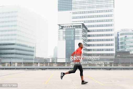 African American runner jogging in city