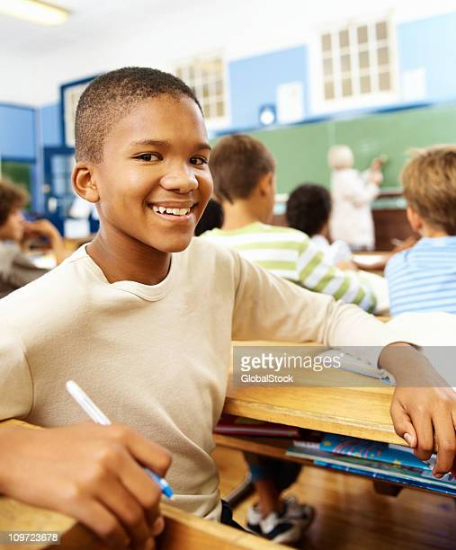African American school boy smiling, classroom view