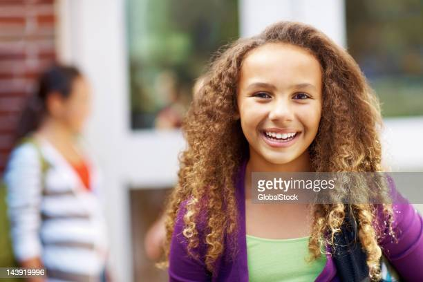 African American school girl smiling