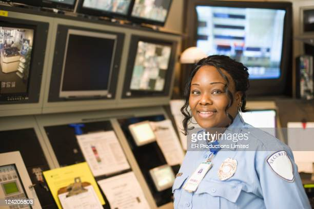 African American security guard in control room