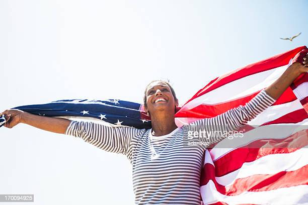African American Senior Carrying USA Flag