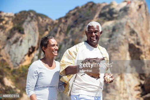 African American Senior Couple Playing Baseball Catch