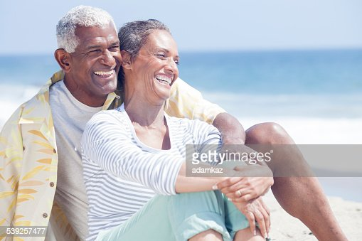 African American Seniors Relaxing on Beach