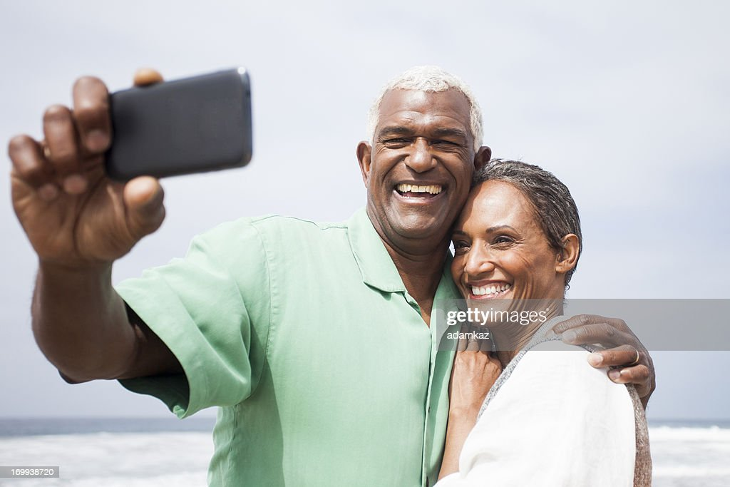 African American Seniors Smiling Together on Beach : Stock Photo