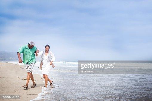 African American Seniors Walking on Beach