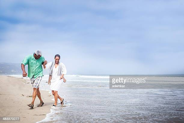 African American Seniors Walking on Beach