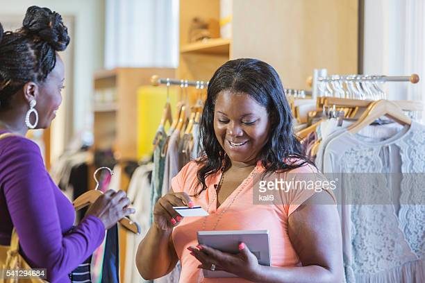 African American shopper and saleswoman in store