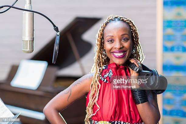 African American singer smiling in studio