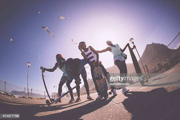 African American skater friends laughing an joking together happily