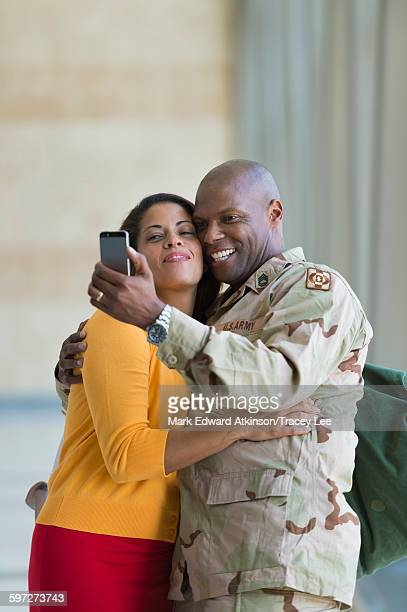 African American soldier and wife taking selfie