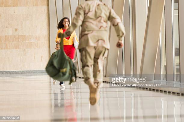 African American soldier greeting wife in airport