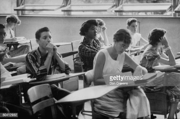 African American student Minnie Ann Dickey sits in a classroom at the recently desegregated Clinton High School Clinton Tennessee early September...