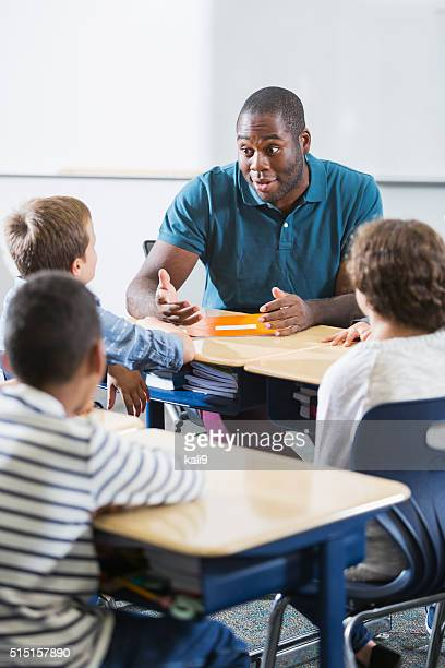 African American teacher and children in classroom