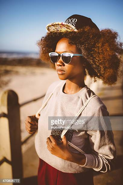 African American teen hipster at the beach in summer