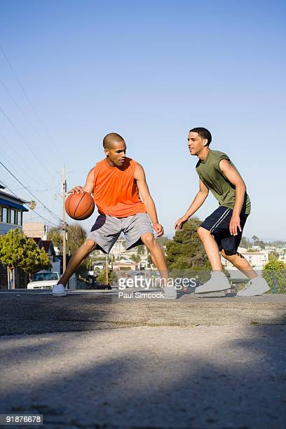 African American Teen Males Playing Basketball