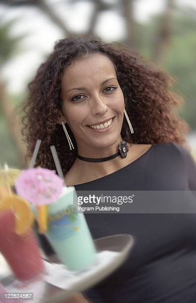 African American Waitress Carrying Tray of Tropical Drinks