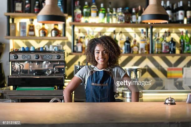 African American waitress serving at a restaurant