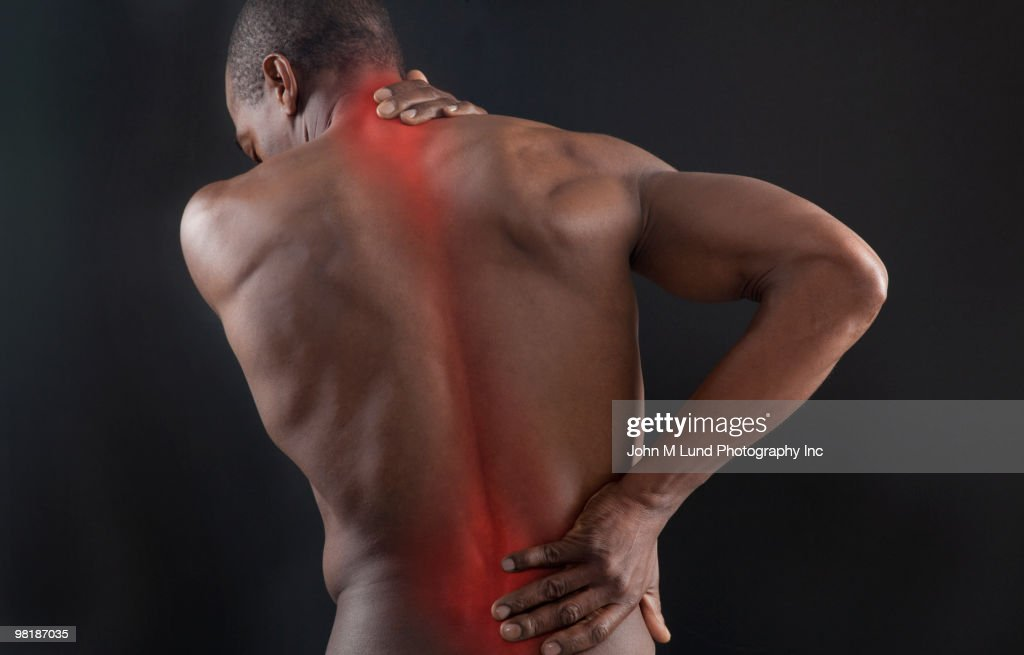 African American with glowing aches in back : Stock Photo