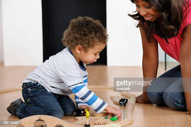 African American Woman And Toddler Playing With Train