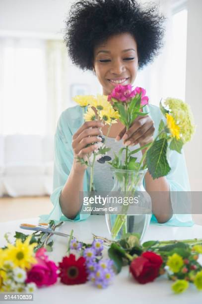 African American woman arranging flowers