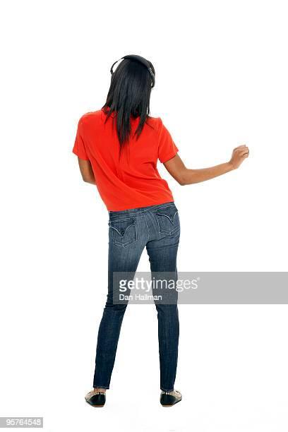 African American woman dancing with headphones.