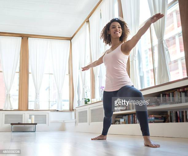 African American woman doing yoga at home