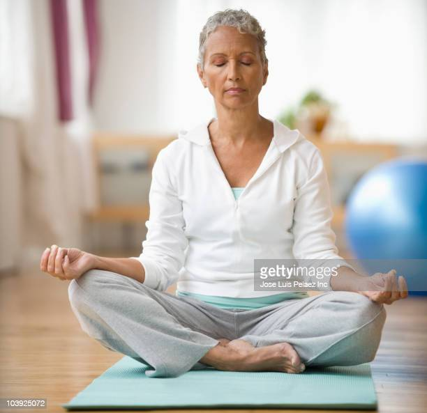 African American woman doing yoga