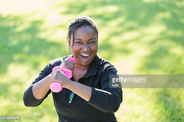 African American woman exercising with dumbbells