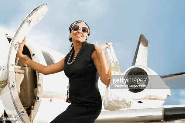 African American woman getting on airplane