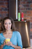 African American woman holding coffee mug