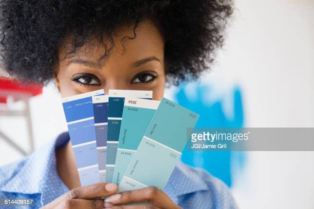 African American woman holding paint swatches