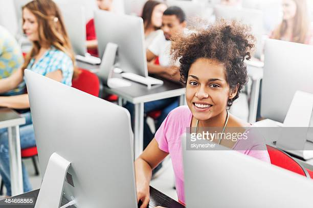 African American woman in a computer lab.