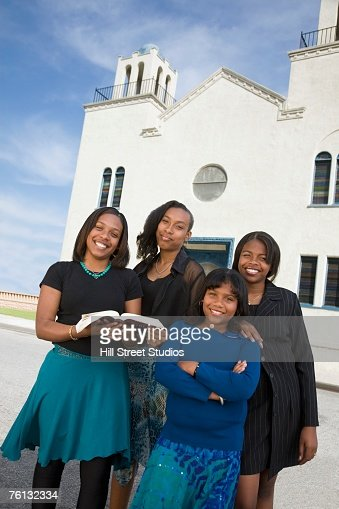 African American woman in front of church : Stock Photo