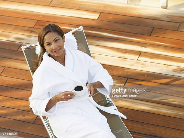 African American woman in spa robe with coffee