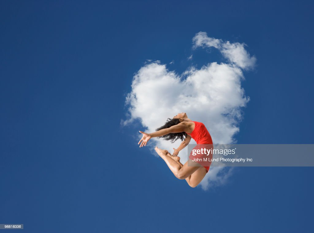 African American woman jumping in mid-air : Stock Photo