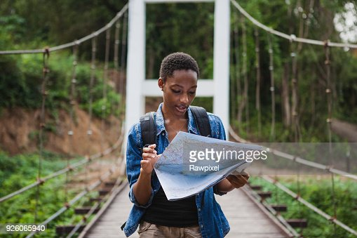 African American woman looking at a map travel and explore concept : Foto de stock