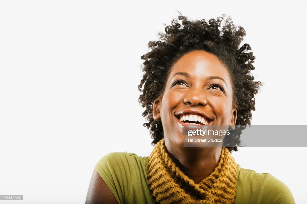 African American woman looking up : Stock Photo