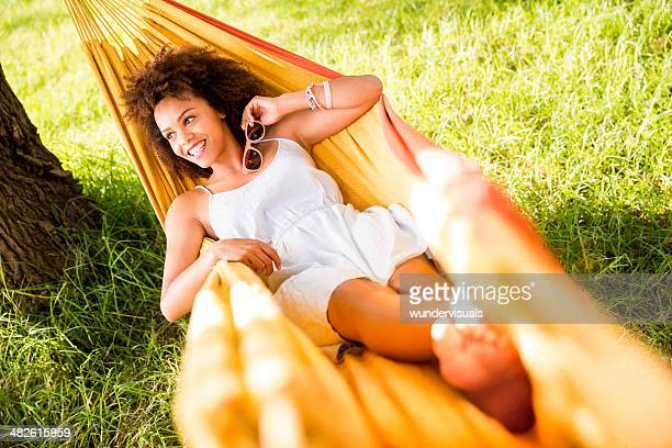 african american woman lying in a hammock