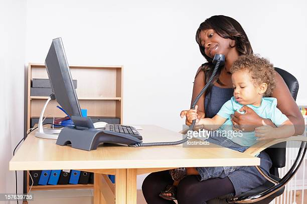 African American Woman Multi-tasking In Her Home Office