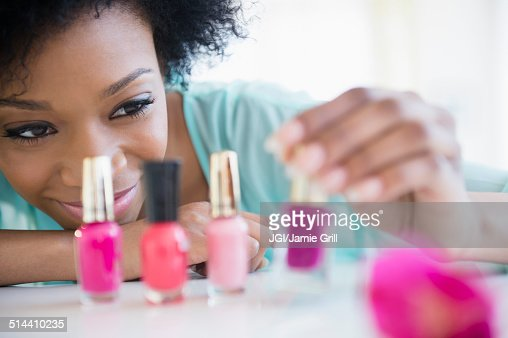 African American woman painting her nails