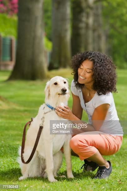 African American woman petting dog