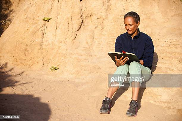 African American Woman Reading Biblia