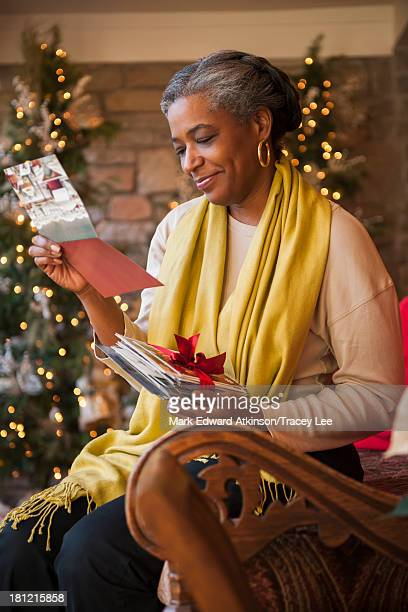 African American woman reading Christmas cards