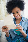African American woman reading letter