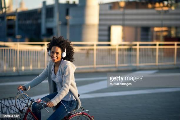 African American woman riding bike